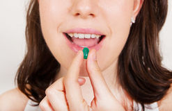Young woman taking pills Royalty Free Stock Photos