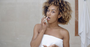 Young Woman Taking Pills Royalty Free Stock Images