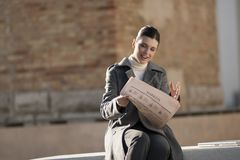 Young woman taking a rest with newspaper Stock Image