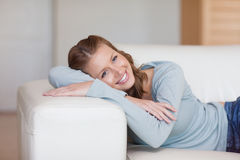 Young woman taking a rest on the sofa Royalty Free Stock Images