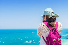Young woman is taking a sea photo on clear sky day Stock Images