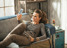 Young woman taking self photo in loft apartment Stock Photo