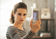 Young woman taking self photo in loft apartment Royalty Free Stock Photo