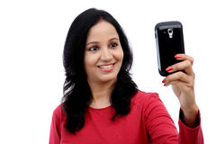Young woman taking self picture Stock Image