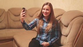 Young woman taking a self-portrait with her. Smartphone stock footage