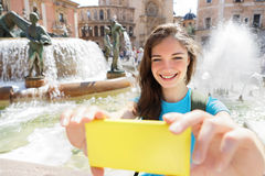Young woman taking self portrait selfie photo on Europe travel Stock Images