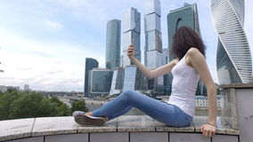 Young woman taking selfie stock footage
