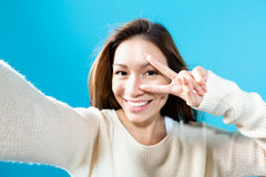 Young woman taking a selfie Stock Photo