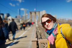Young woman taking a selfie on Brooklyn Bridge Royalty Free Stock Photos