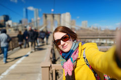 Young woman taking a selfie on Brooklyn Bridge Stock Photography