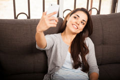 Young woman taking selfie Stock Image