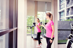 Young woman taking selfie. Fitness lifestyle. Pretty young woman taking selfie in gym Stock Images