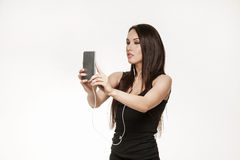Young woman taking selfie at the gym Royalty Free Stock Photography