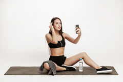 Young woman taking selfie at the gym Royalty Free Stock Photos