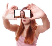 Young woman taking selfie with mobile phone Stock Photo