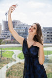 Young woman taking a selfie outdoor Stock Photos