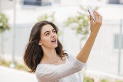 Young woman taking a selfie outdoor Royalty Free Stock Images