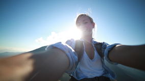 Young woman taking selfie outdoors stock video footage