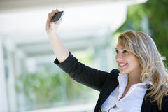 Young woman taking a selfie. Young woman taking a self portrait Stock Photography