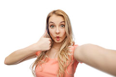 Young woman taking selfie and showing thumbs up Stock Photos