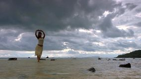 Young woman taking a selfie with smartphone on the. Beach in Koh Samui Thailand stock video footage