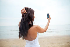 Young woman taking selfie with smartphone Royalty Free Stock Photography