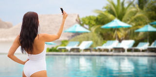 Young woman taking selfie with smartphone Stock Image