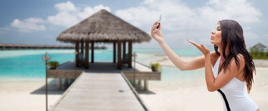 Young woman taking selfie with smartphone Stock Photography