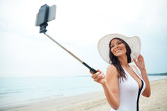 Young woman taking selfie with smartphone Royalty Free Stock Images