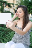 Young woman taking selfie with a tablet Stock Photography