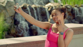 Young woman taking selfie and watch photo on smartphone stock video footage