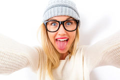 Young woman taking a selfie. Young woman in winter clothes taking a selfie Stock Photography