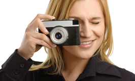 Young woman taking a shot with photo camera Royalty Free Stock Photos