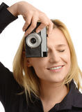 Young woman taking a shot with photo camera Royalty Free Stock Images
