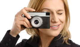 Young woman taking a shot with photo camera Stock Photography