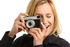 Young woman taking a shot with photo camera Royalty Free Stock Photo