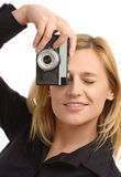 Young woman taking a shot with photo camera Stock Photos