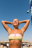 Young woman taking shower. Sensous slim woman taking shower at the beach Stock Photography