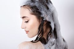 Young woman taking shower. On white background Stock Image