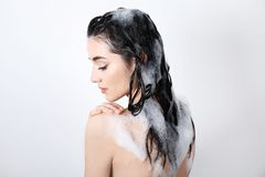 Young woman taking shower  on white background Royalty Free Stock Photos