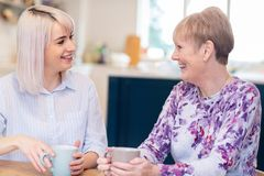 Free Young Woman Taking Time To Visit Senior Female Neighbor And Talk Royalty Free Stock Photos - 142611618