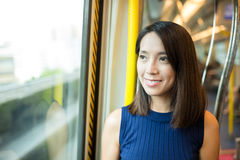 Young woman taking the train in Hong Kong Stock Photography