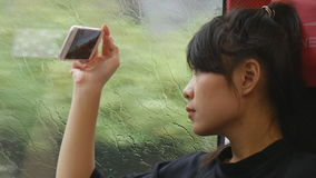 Young woman taking video with cellphone stock video footage