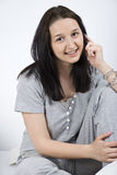 Young woman talk at cell in bed Royalty Free Stock Photo