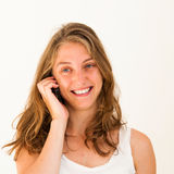 Young woman talk on a cellular telephone Stock Photography