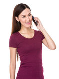 Young woman talk to cellphone Royalty Free Stock Photo