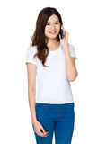 Young woman talk to cellphone Royalty Free Stock Image