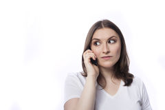 Young woman talk to mobile phone Royalty Free Stock Photography