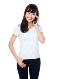 Young woman talk to mobile phone Royalty Free Stock Images