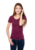 Young woman talk to mobile phone Stock Images